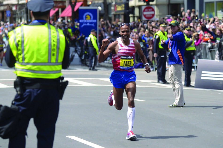 American+Meb+Keflezighi+wins+the+118th+Boston+Marathon%2C+a+year+after+deadly+bombings%2C+near+the+Marathon+finish+line+in+Boston%2C+Monday%2C+April+21%2C+2014.+Keflezighi+is+the+first+American+male+to+win+since+1983.+%28Patrick+Raycraft%2FHartford+Courant%2FMCT%29