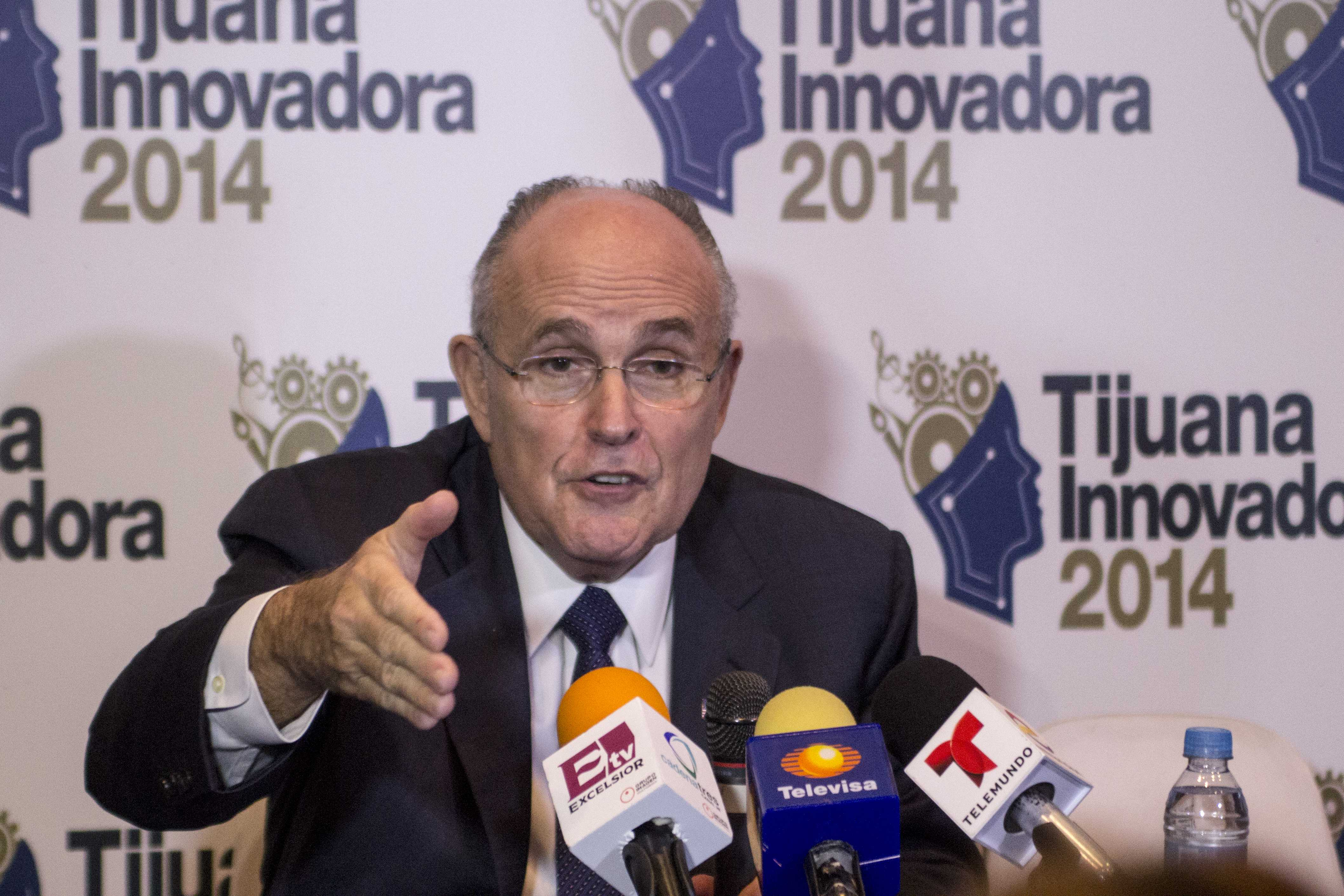 Former New York City Mayor Rudy Giuliani speaks about how the city restructured its Police Department diminish crime rates. He spoke at a press conference Oct. 19 at CECUT, Cultural Center of Tijuana, headquarters of Tijuana Innovadora. (Photo by Celia Jimenez)