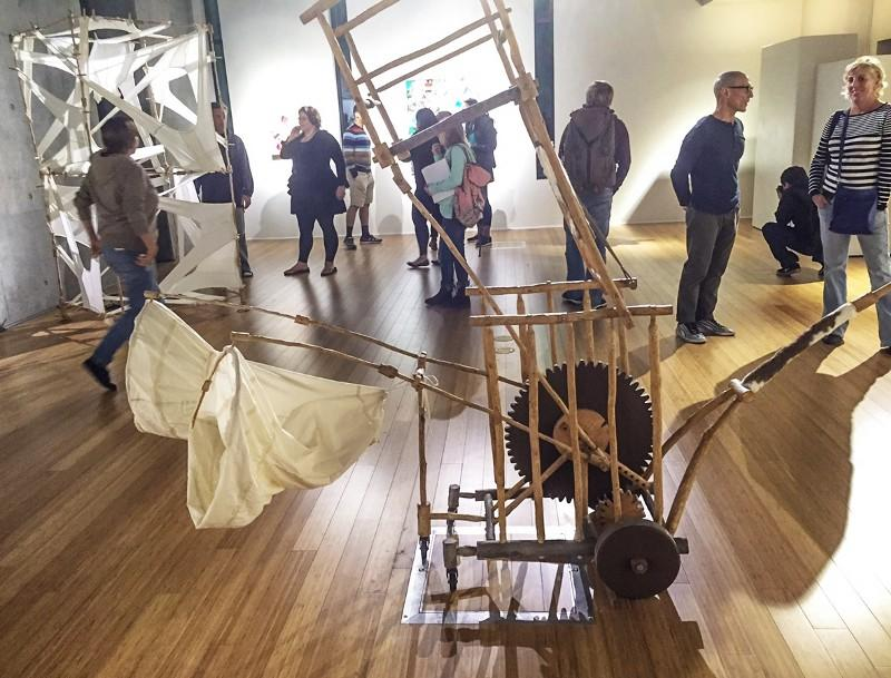 Fine+art+professors+Wayne+Hulgin+and+Terry+Hughes-Oelrich+%28far+right%29+chat+while+students+from+their+art+classes+examine+the+works+in+the+gallery.+%28Photo+by+Lupe+Diaz%29