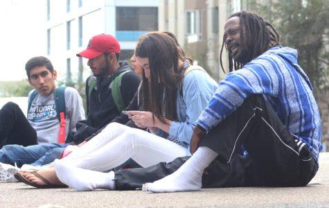 Alumnus alleges police abuse, stops traffic on C Street