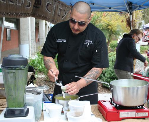 Chef Ricardo Heredia holds a cooking demonstration March 21 at Gorton Quad, hosted by Seeds@City. Michelle Moran, City Times