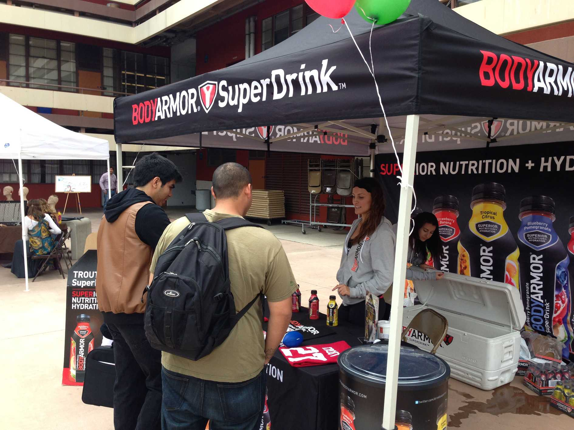 Students receive free energy drinks at the Body Armor Super Drink stand on April 30. Paul Smoot, City Times