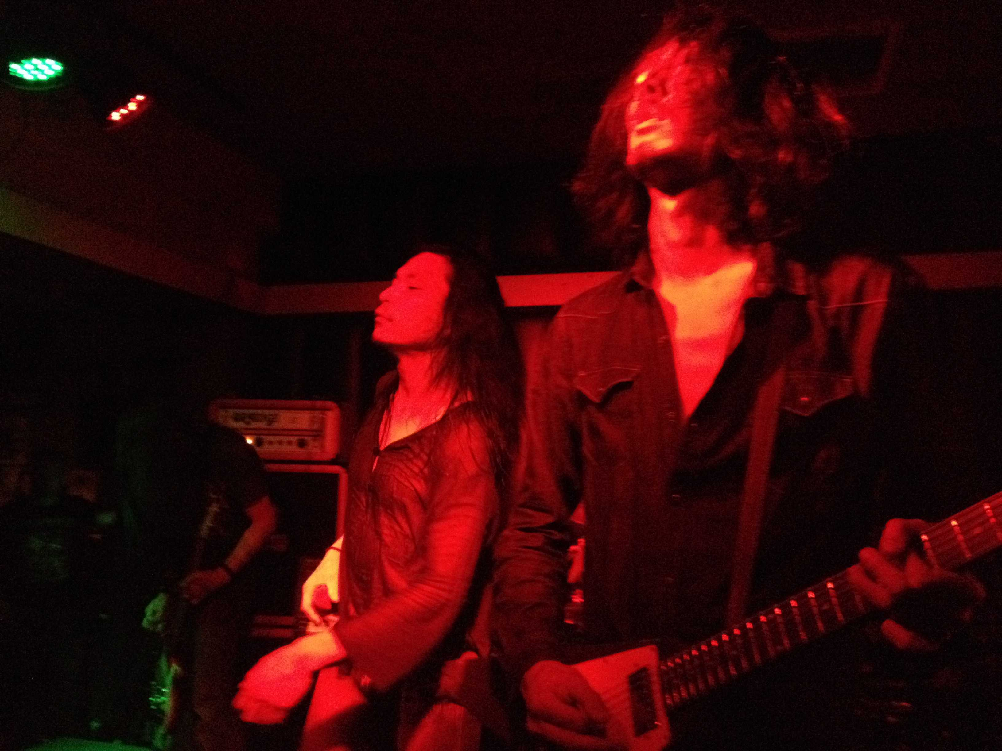 On the far left is bassist and founder Tatsu Mikami, center vocalist Hideki Fukasawa, right lead guitarist Ikuma Kawabe. From their Thanksgiving show at San Diego's Soda Bar. Jennifer Ovalle, City Times.