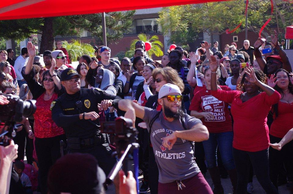 Coach+Alan+Rivera+joins+president+Neault%2C+ASG+president+Carolina+Moreno%2C+Officer+Sean+McPhearson%2C+and+many+others+in+a+flash+mob+dance.Photo+credit%3A+Joe+Kendall