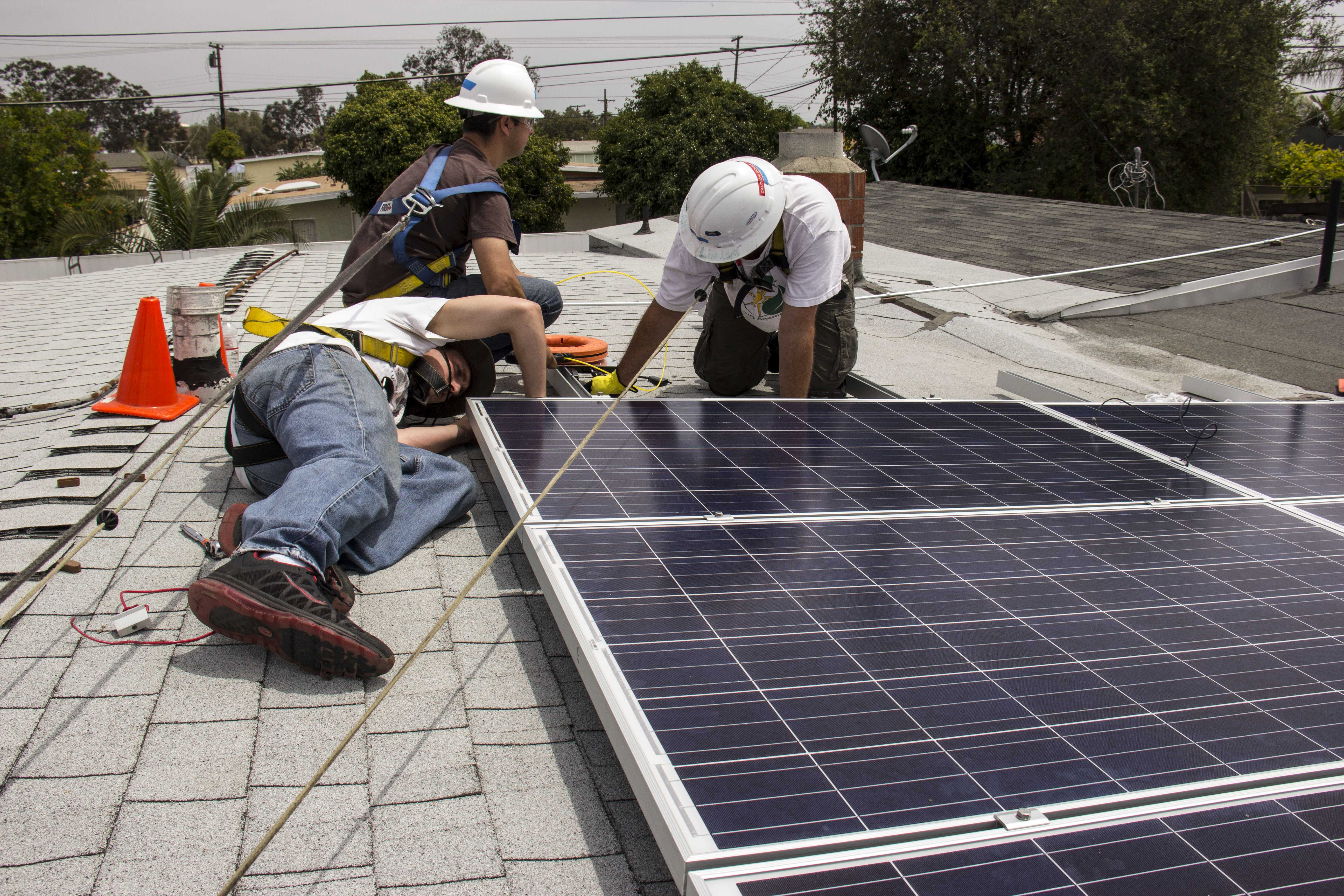 A team of City College students worked with GRID Alternatives to install a solar energy system. Photo credit: Celia Jimenez