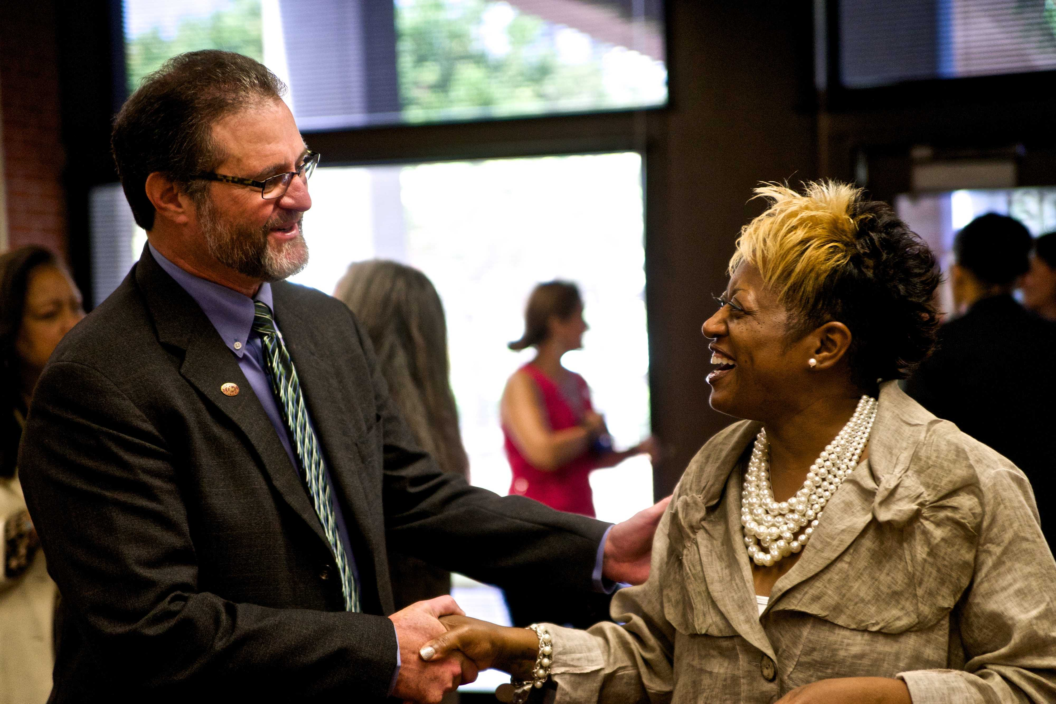 City College President Anthony Beebe speaks with cosmetology instructor Patricia Grooms-Jones  at  an Aug. 4 mixer introducing Beebe to faculty and staff. Photo credit: Troy Orem