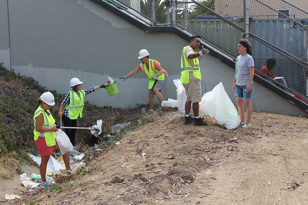 A group of volunteers joins together during a Sept. 20 event organized to clean up Cesar Chavez Park in Barrio Logan. Photo credit: Miguel Cid