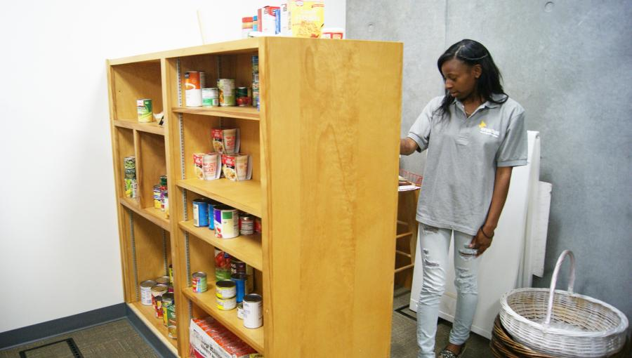 Bridgette+Babers%2C+a+student+involved+in+the+Small+Business+Entrepreneur+Program%2C+restocks+food+in+the+pantry.+Photo+credit%3A+Lydia+Grijalva