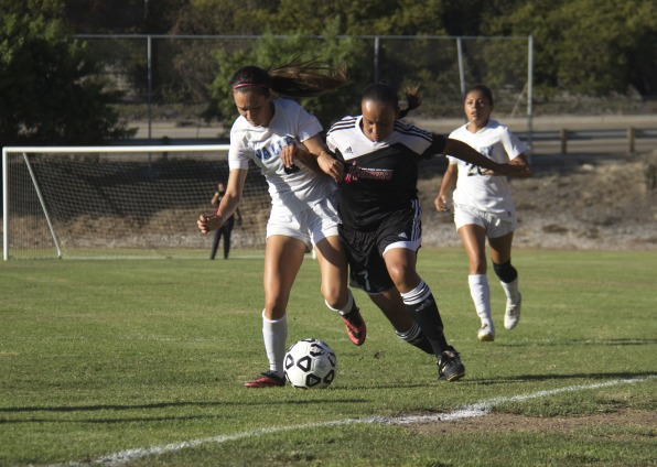 San Bernardino forward Veronica Parker (left) and City College midfielder Rebecca Garcia (right) fight to gain control of the ball during a home game at San Diego City College soccer field on Sept. 19.  Photo Credit: Celia Jimenez