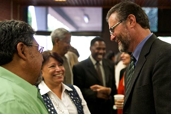 San Diego City College President Anthony Beebe greets teachers and staff at an Aug. 4 mixer. Photo credit: Troy Orem
