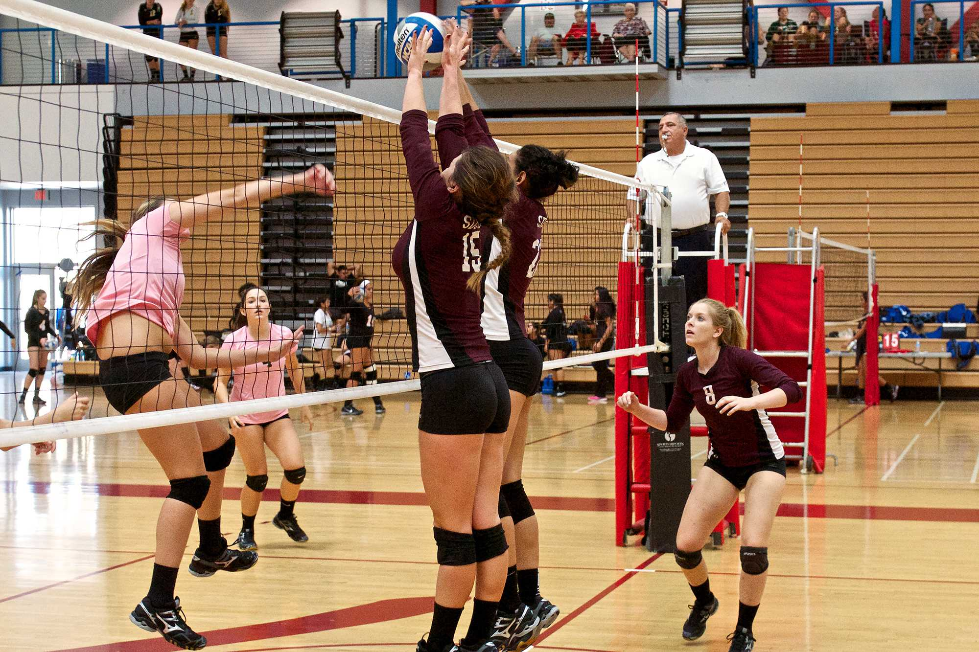 Sophomores Lisette Kelly (#15) and Mia Torres (#22)  block  the ball from  an opponent from College of the Desert during the San Diego City College tournament on Sept. 27 where they finished second  overall out of 13 teams. Photo credit: Troy Orem