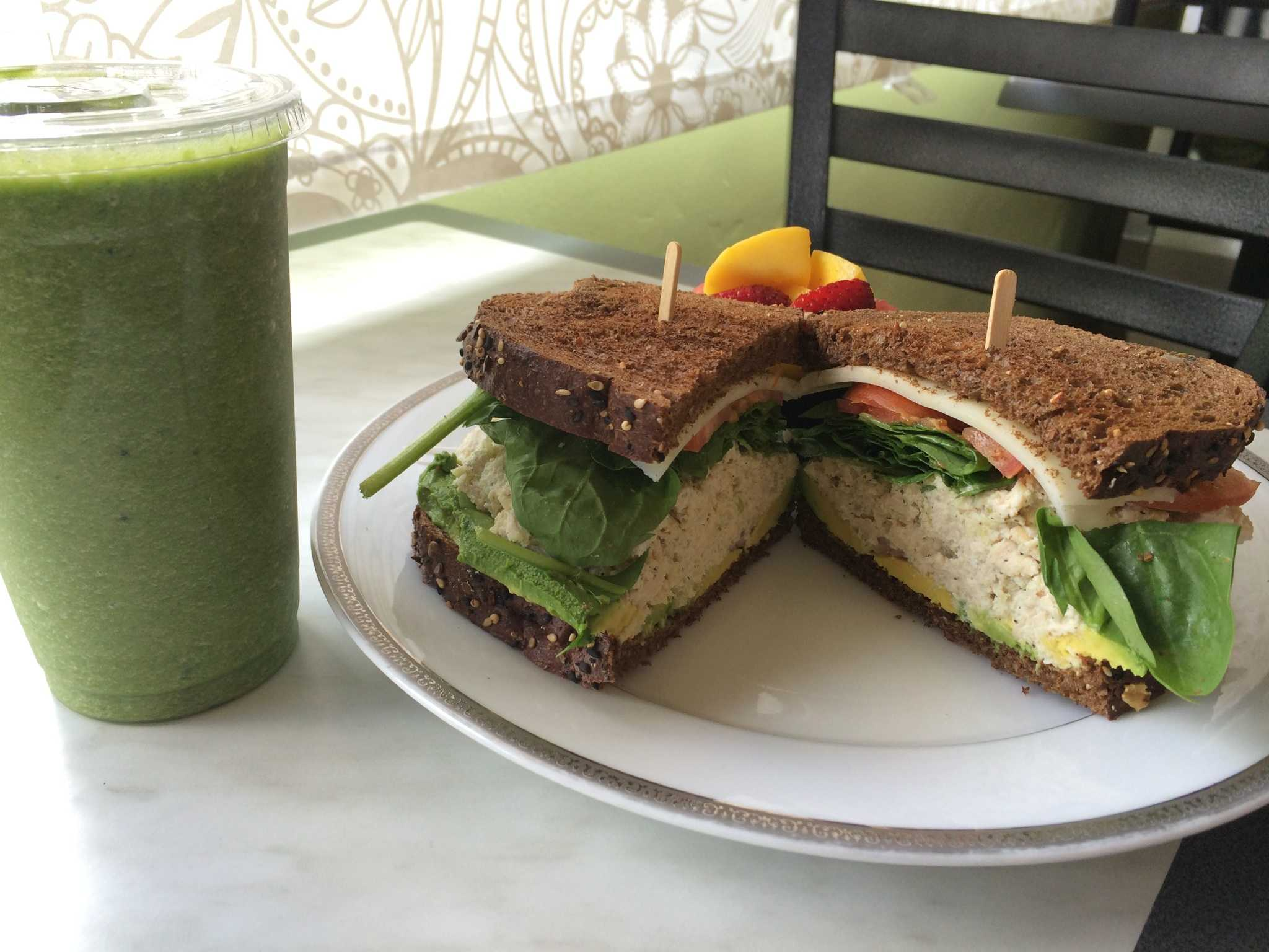 The Liv Green Smoothie contains cactus, pineapple and various fruits. The Chicken Salad Sandwich includes baby spinach, red onion, slices of avocado and provolone cheese. Photo credit: Franchesca Walker
