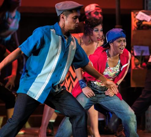 """Christine Bernadette Ondevilla (right) performing in the Spring 2014 musical """"In the Heights."""" Legend Magazine file."""