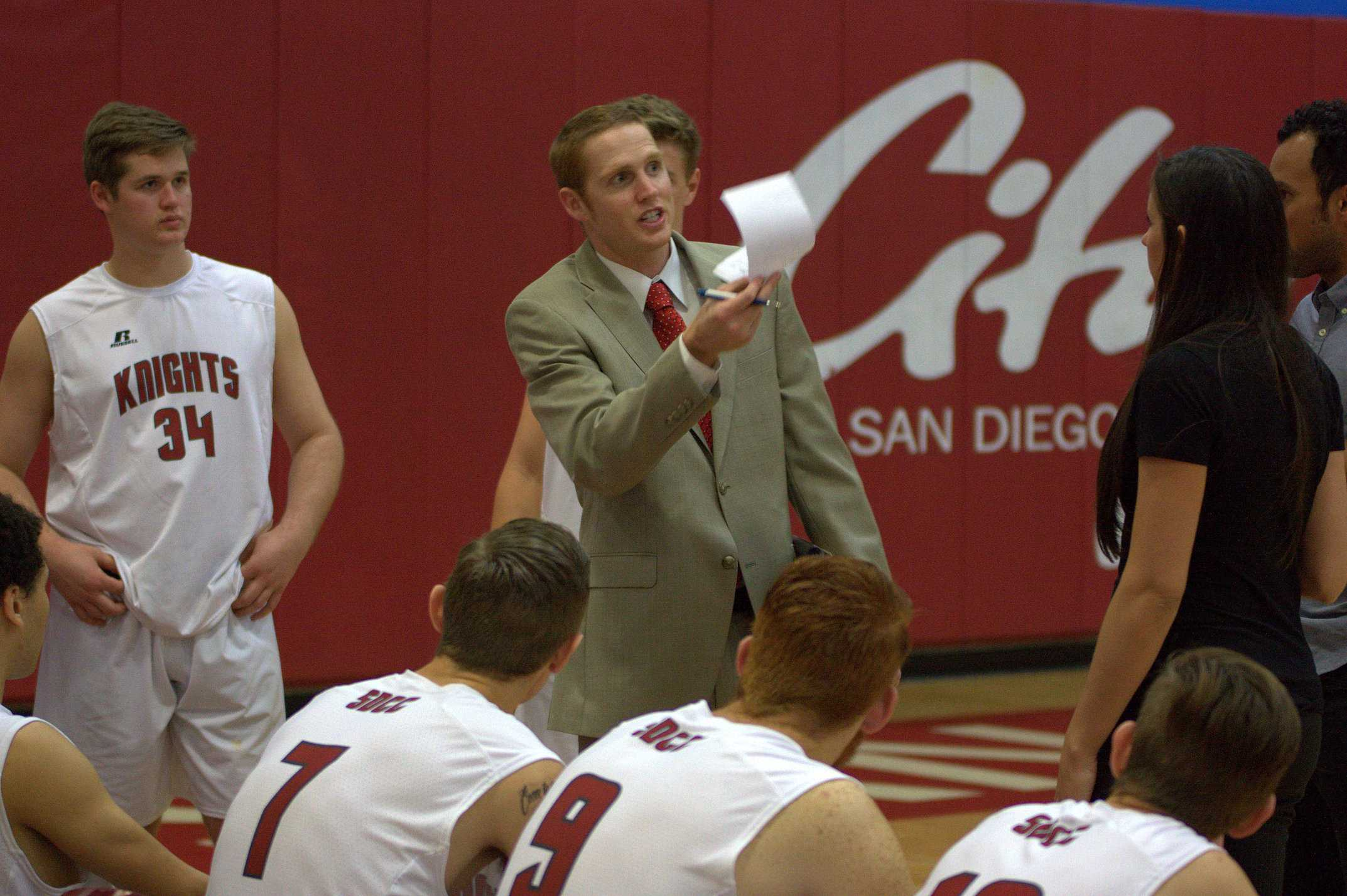 After losing their first set against El Camino College in the home opener on Feb. 13, Head Coach Kevin Pratte talks to the men's volleyball team about finding a way to stay in the match. Photo credit: David Pradel