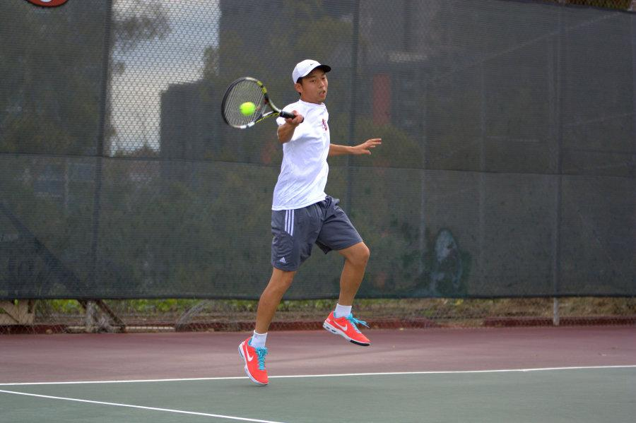 Sophomore+tennis+player+David+Lin+hits+the+ball+during+the+doubles+round+against+Palomar+College+on+March+17+at+the+SDCC+Tennis+Courts.+Photo+credit%3A+David+Pradel