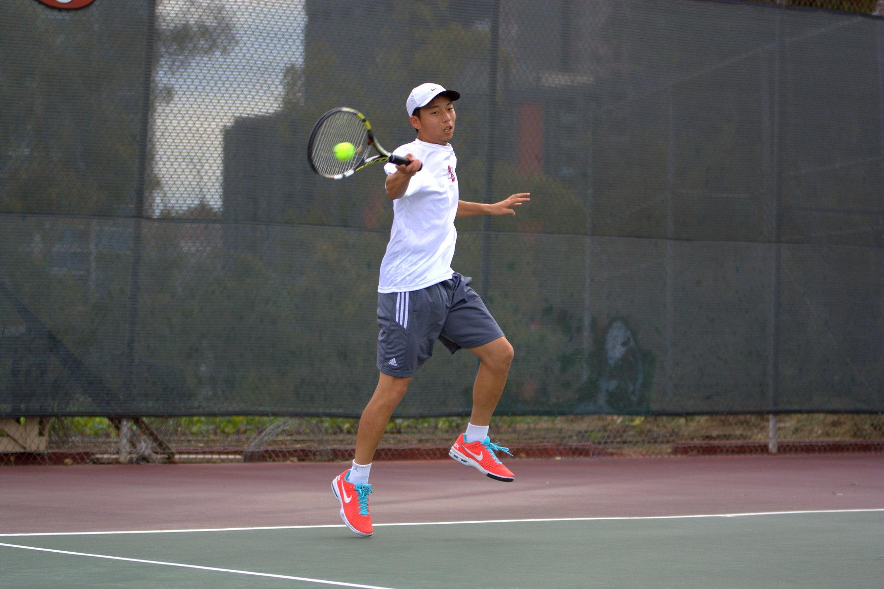 Sophomore tennis player David Lin hits the ball during the doubles round against Palomar College on March 17 at the SDCC Tennis Courts. Photo credit: David Pradel