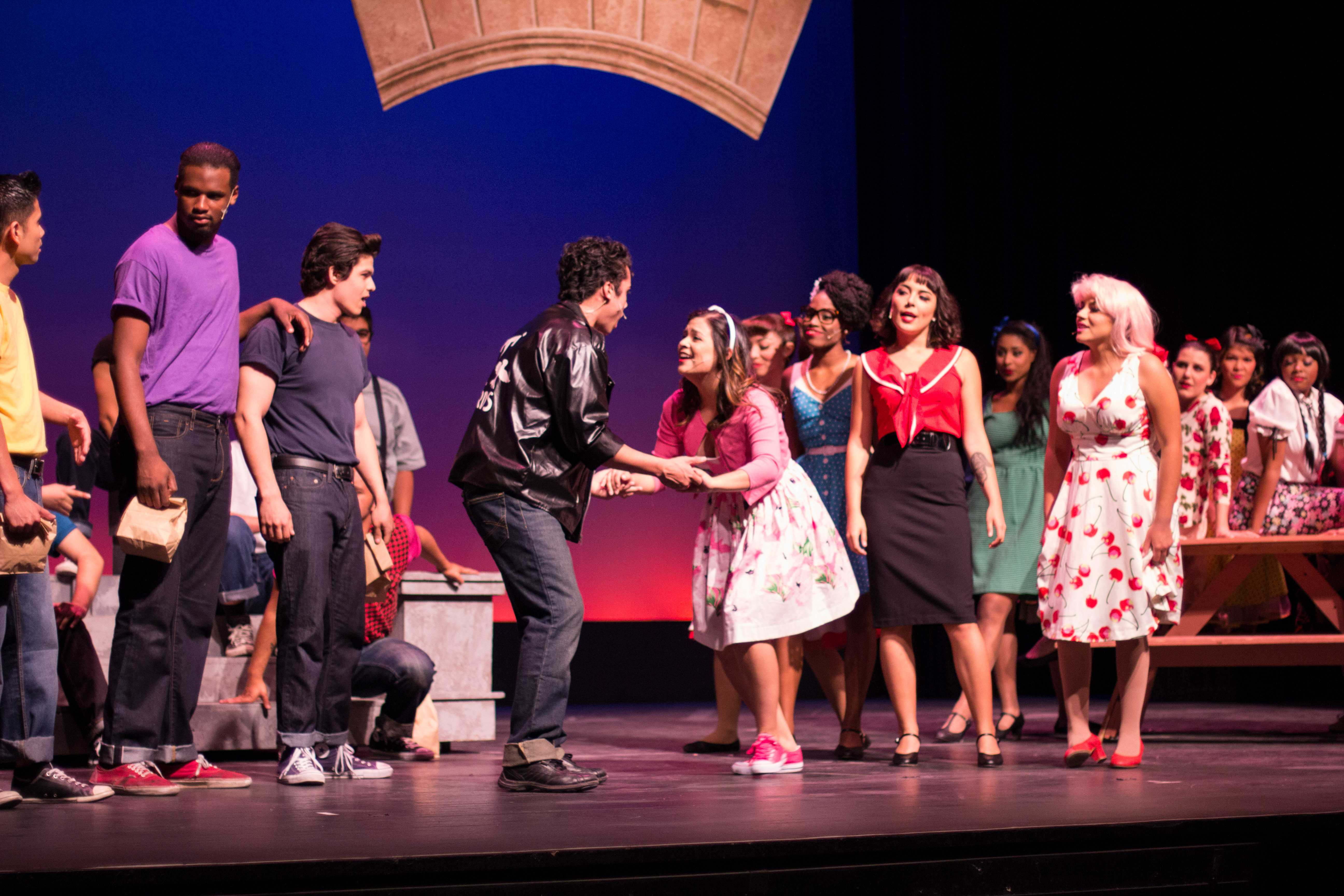 "Cast members of the musical ""Grease"" sing and dance to multiple songs on opening night April 10. The musical will run until April 26  at the Saville Theatre. Photo credit: Torrey Spoerer"