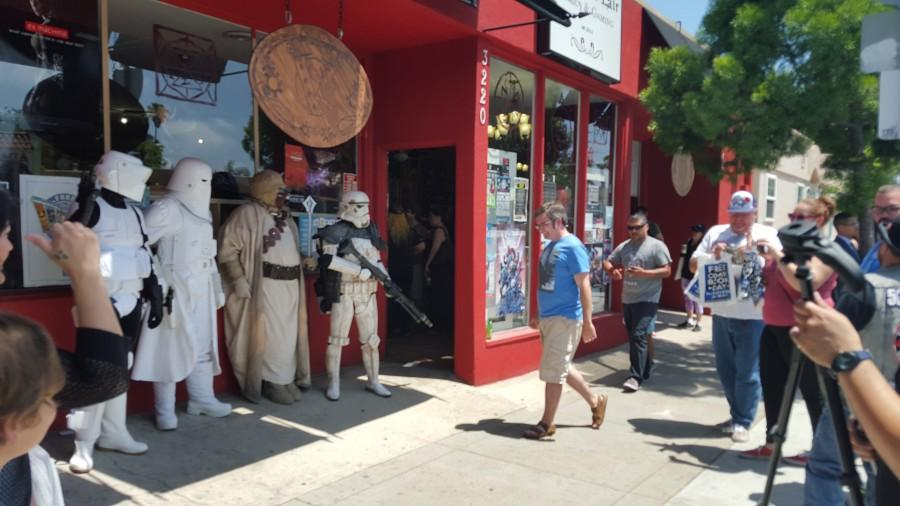 Fans%2C+photographers+and+various+Star+Wars+characters+line+the+entrance+to+Villainous+Lair+Comics+%26+Gaming+on+Adams+Avenue+during+Free+Comic+Book+Day+on+May+2.+Photo+credit%3A+Antonio+Marquez