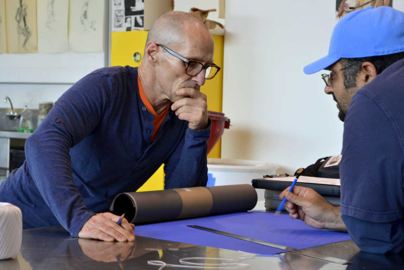 Professor Wayne Hulgin helps a student during one of his drawing classes in room AH-301 at San Diego City College. Photo credit: Edgar Inda