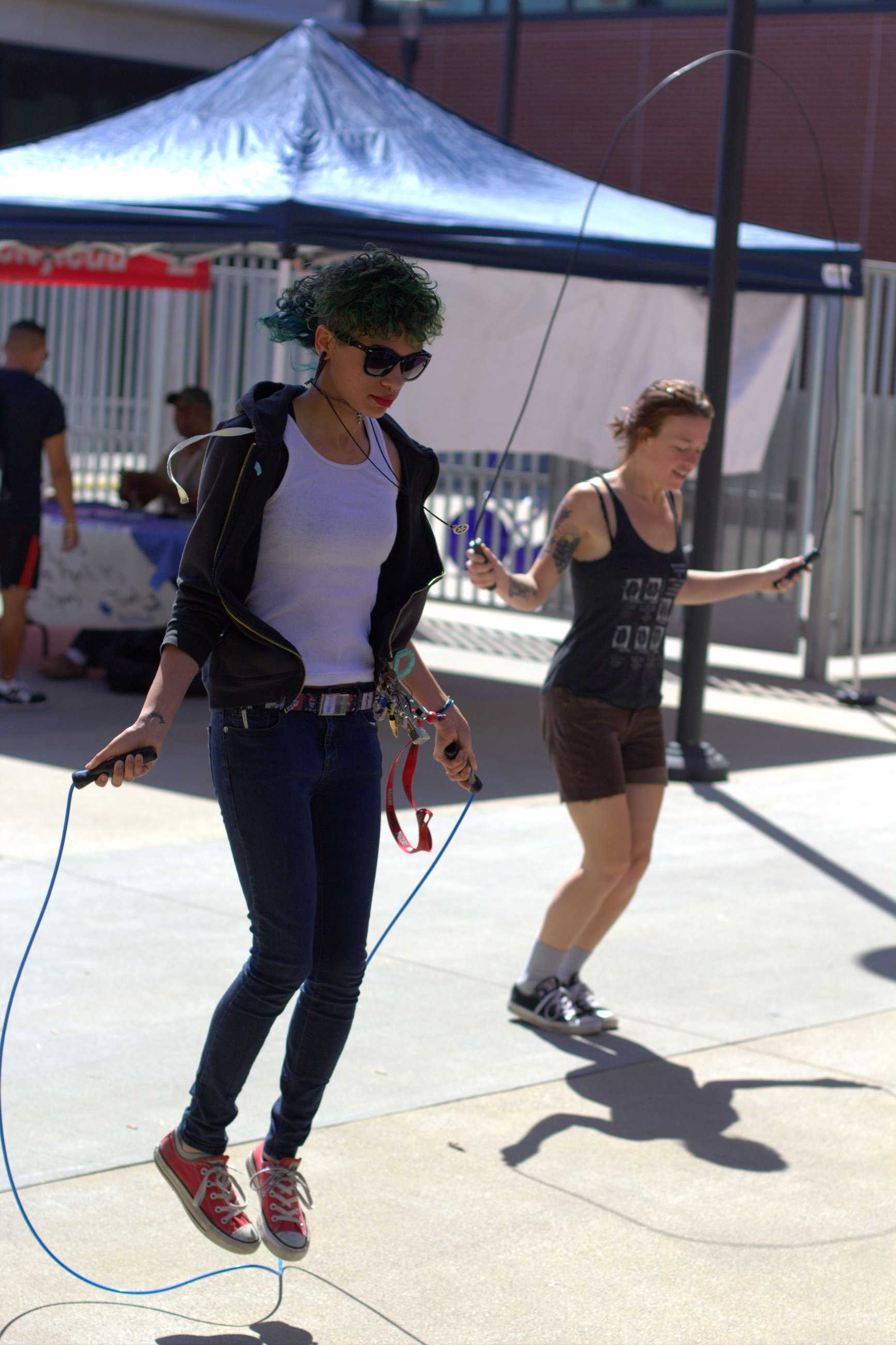 San Diego City College students Alice Kiddo (front) and Bri Rochstein (back) participate at the seventh station during the Health and Wellness Expo on April 10 that was held at the AH/BT quad. Photo credit: David Pradel