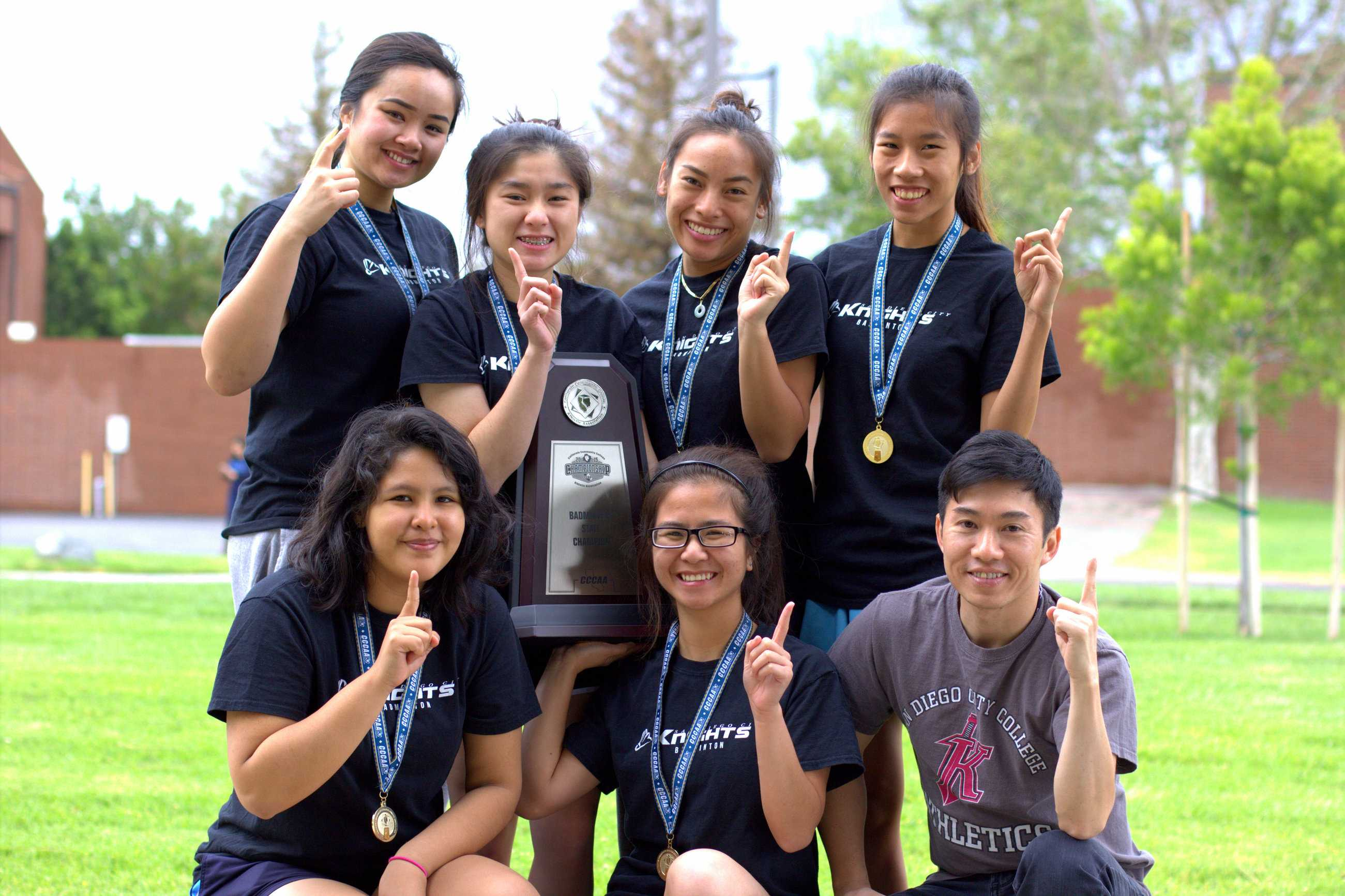 The 2015 City College badminton team poses for a team photo on May 8 at Irvine Valley College. (Top left to bottom right) Sophomores Cassandra Ka, Trinh Lang, Gina Niph, freshmen Thao Le, Shessira Paredes, Margaret Do and Head Coach Son Nguyen. Photo credit: David Pradel