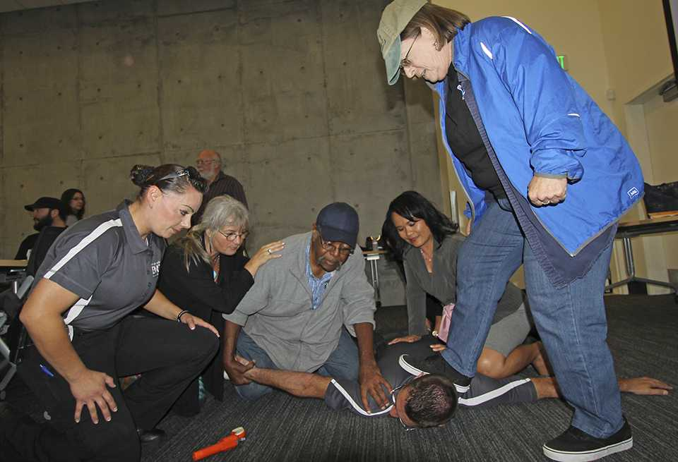 Officer Richard Farrell is restrained by members of San Diego City College's staff and a fellow police officer during the Alert, Lockdown, Inform, Counter, Evacuate (ALICE) Training class in MS-140 on Oct. 22. Photo credit: Mike Madriaga