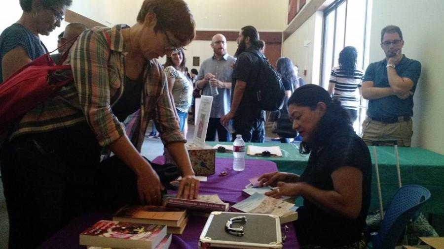 Author+Reyna+Grande+%28right%29+signs+copies+of+her+book+%E2%80%9CThe+Distance+Between+Us%3A+A+Memoir%E2%80%9D+during+the+10th+annual+San+Diego+City+College+International+Book+Fair+on+Oct.+13+in+the+Saville+Theatre+on+campus.+++Official+Facebook+photo.