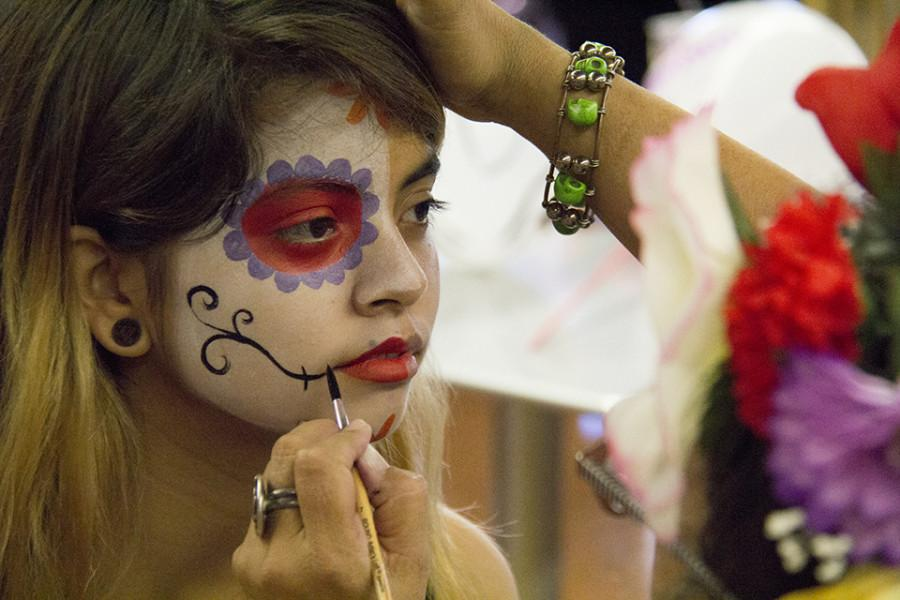 Students+had+the+opportunity+to+get+their+faces+painted+in+the+cafeteria+for+the+Day+of+the+Dead+celebration+on+Oct.+29.+Photo+credit%3A+Celia+Jimenez