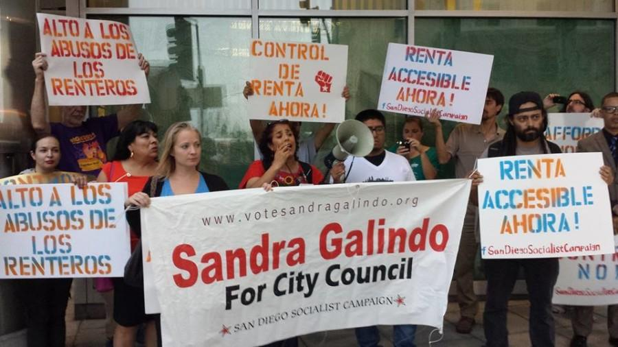 Surrounded+by+protesters+and+campaign+supporters+from+the+San+Diego+Socialist+Campaign%2C+Sandra+Galindo+%28center%29+speaks+at+a+renters+rights+rally+on+Sept.+21+in+City+Heights.++++Official+Facebook+photo