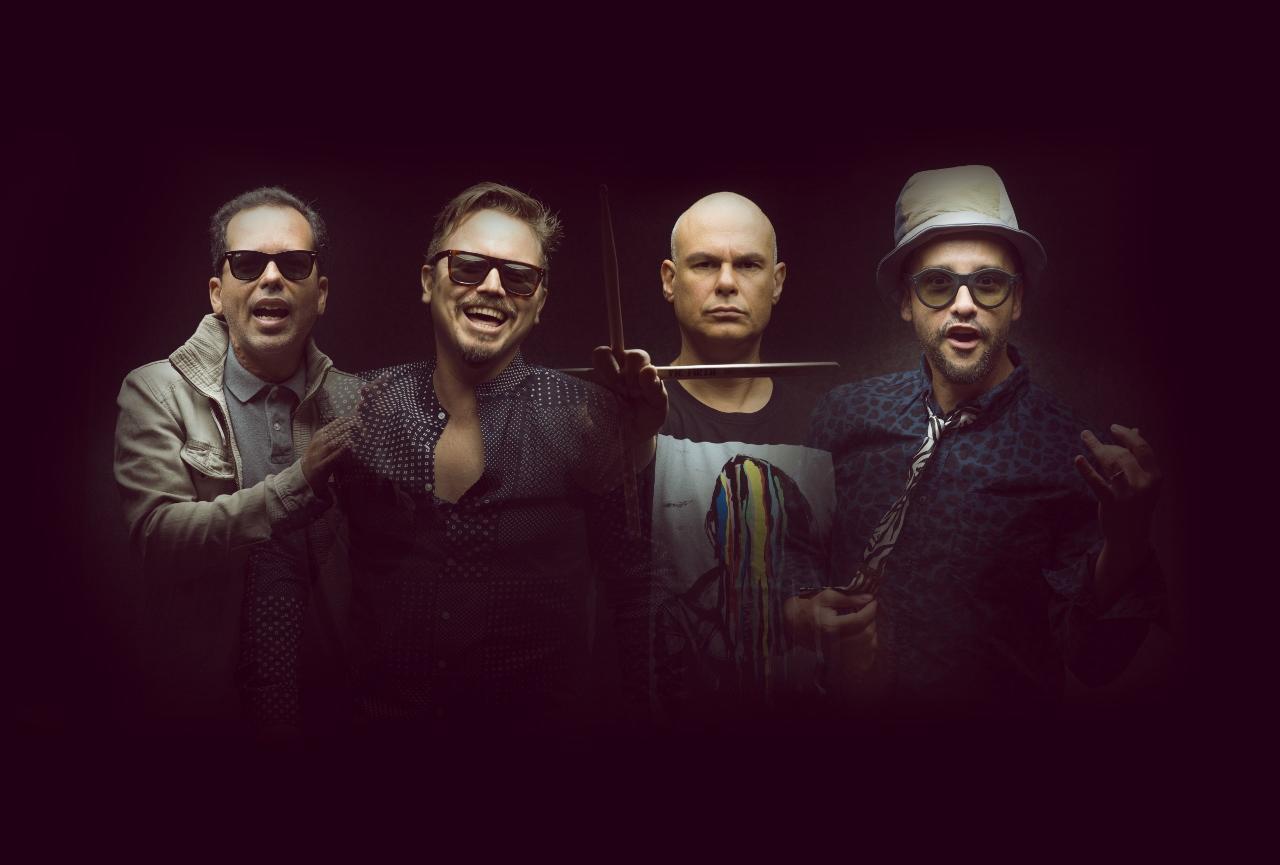 Los Amigos Invisibles. Official Facebook page photo.