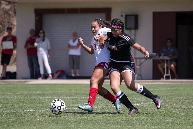 City+College+freshman+midfielder+Kassandra+Herrera+%28number+9%29+and+Santa+Ana+freshman+forward++Kelly+Becerra+fight+in+the+midfield+for+control+of+the+ball+at+San+Diego+City+College+soccer+field+on+Aug.+26.+Photo+by+Celia+Jimenez