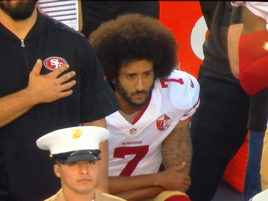 Quarterback+Colin+Kaepernick%2C+of+the+49ers%2C+sat+down+during+the+playing+of+the+national+anthem+before+the+pre-season+game+against+the+Chargers+on+Sept.+1+at+Qualcomm+Stadium.+Photo+by+Gabe+Rivera