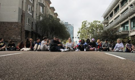 Others joined Royce Allen Green as he sat-in on C Street by the AH Building. Photo: Mike Madriaga