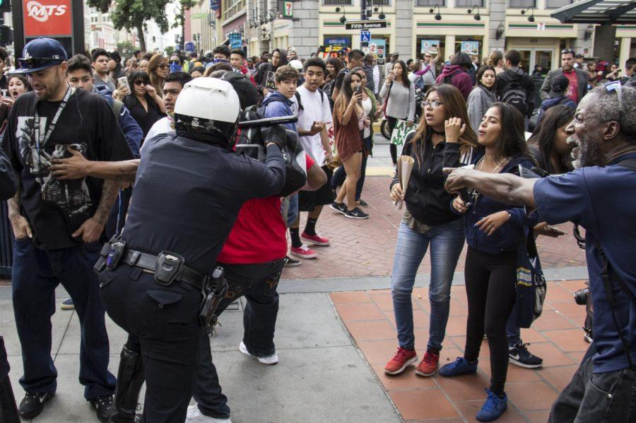 A+San+Diego+police+officer+clashes+with+a+young+man+during+a+march+Nov.+16+through+downtown+streets+to+protest+the+election+of+Donald+Trump+as+president.+