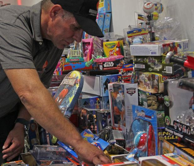 Robert+Crouse%2C+a+former+City+College+student%2C+helped+to+gather+over+4%2C000+new+toys+and+clothing+articles+to+donate.++