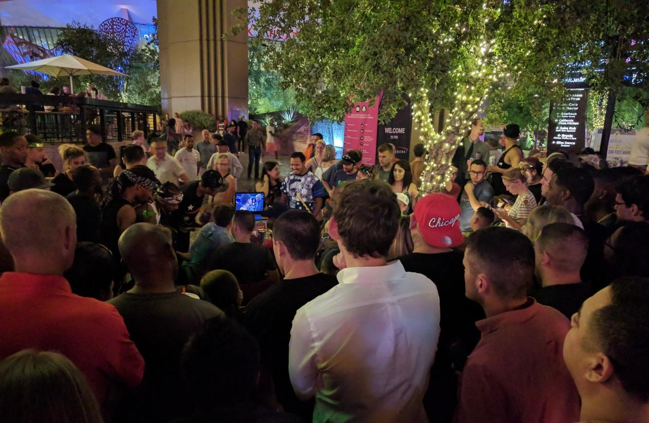 Fans without tickets for the arena or the sold-out bars that were showing the fight gather around a laptop outside Shake Shack, Las Vegas, Aug. 26.