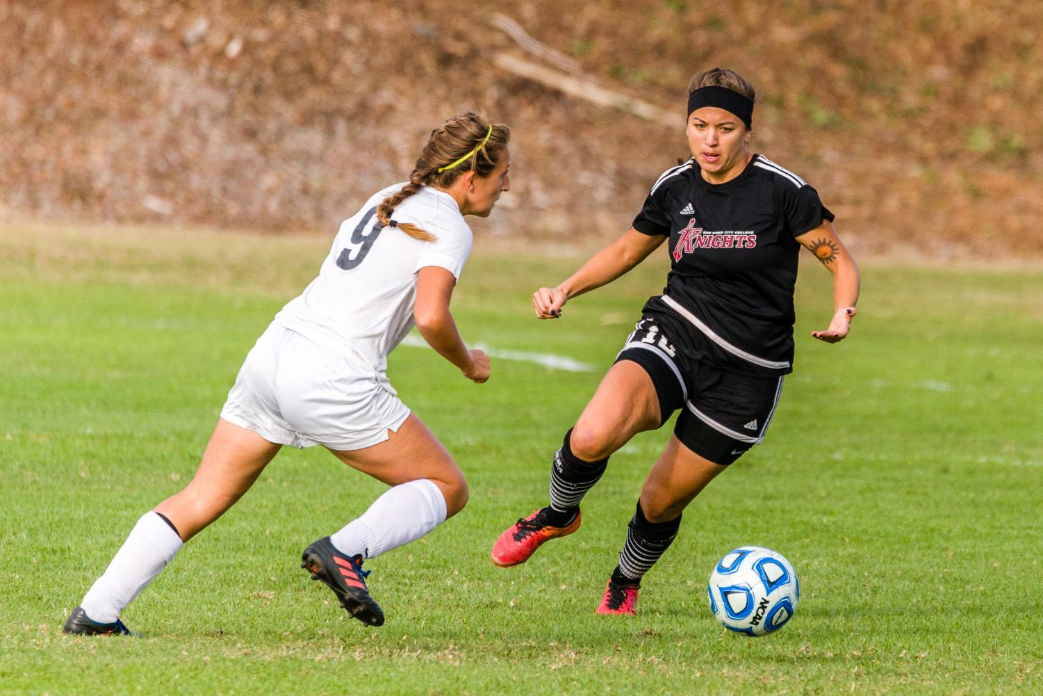 Knights defender, Giulianna Orlandoni, clears the danger against Sam Smith of the Miramar Jets, Oct. 20.