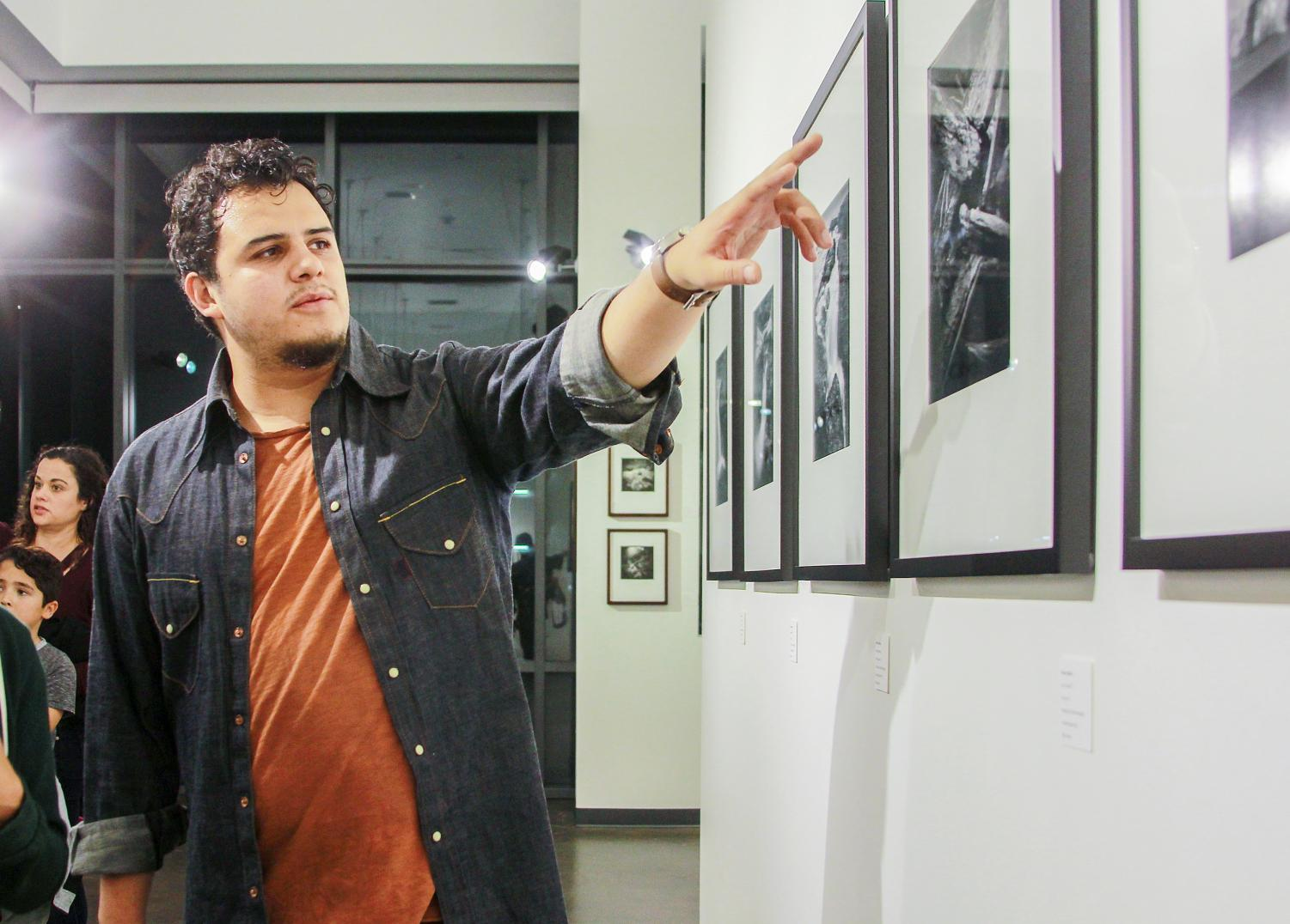 Photography student and exhibition curator Hector Valdivia explains his process in creating five prints for the new show in the Luxe Gallery at San Diego City College, Nov. 9.
