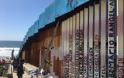 Tijuana artist works to paint the longest mural on the border wall