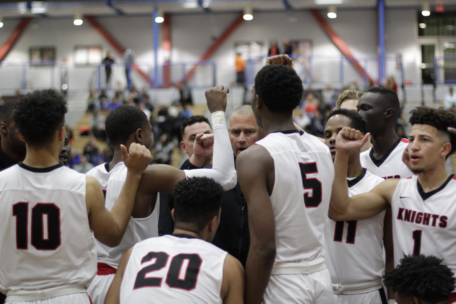 Head Coach Mitch Charlens encouraging his players during half-time against their game to the Pirates of Ventura College at the Harry West Gymnasium.