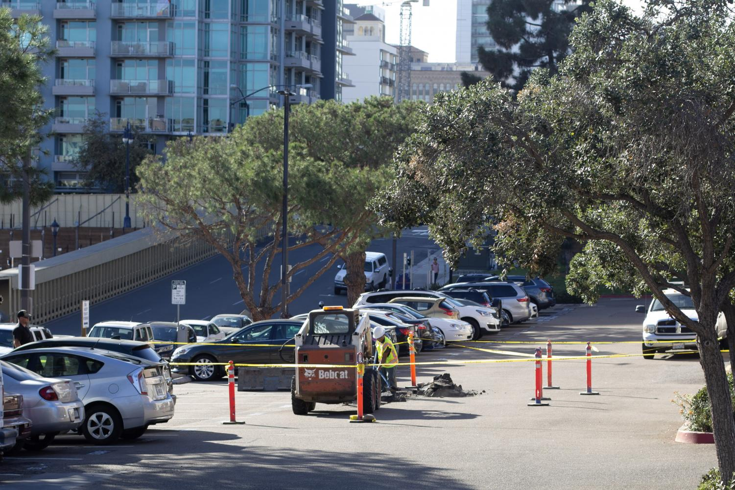 Facilities immediately started working on stopping the water leak in parking lot 8. Photo by David Ahumada, City Times.