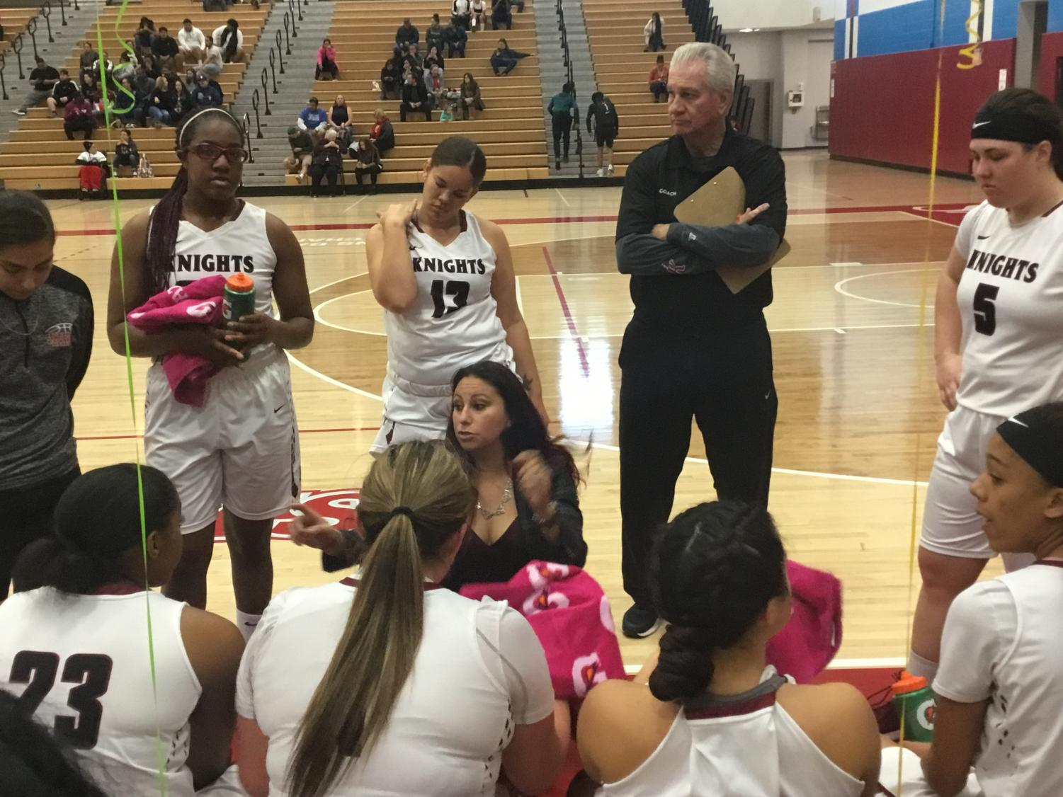 Coach Andrea Aguilar-Montalban speaks to players during final game of the season. By Sonny Garibay/City Times