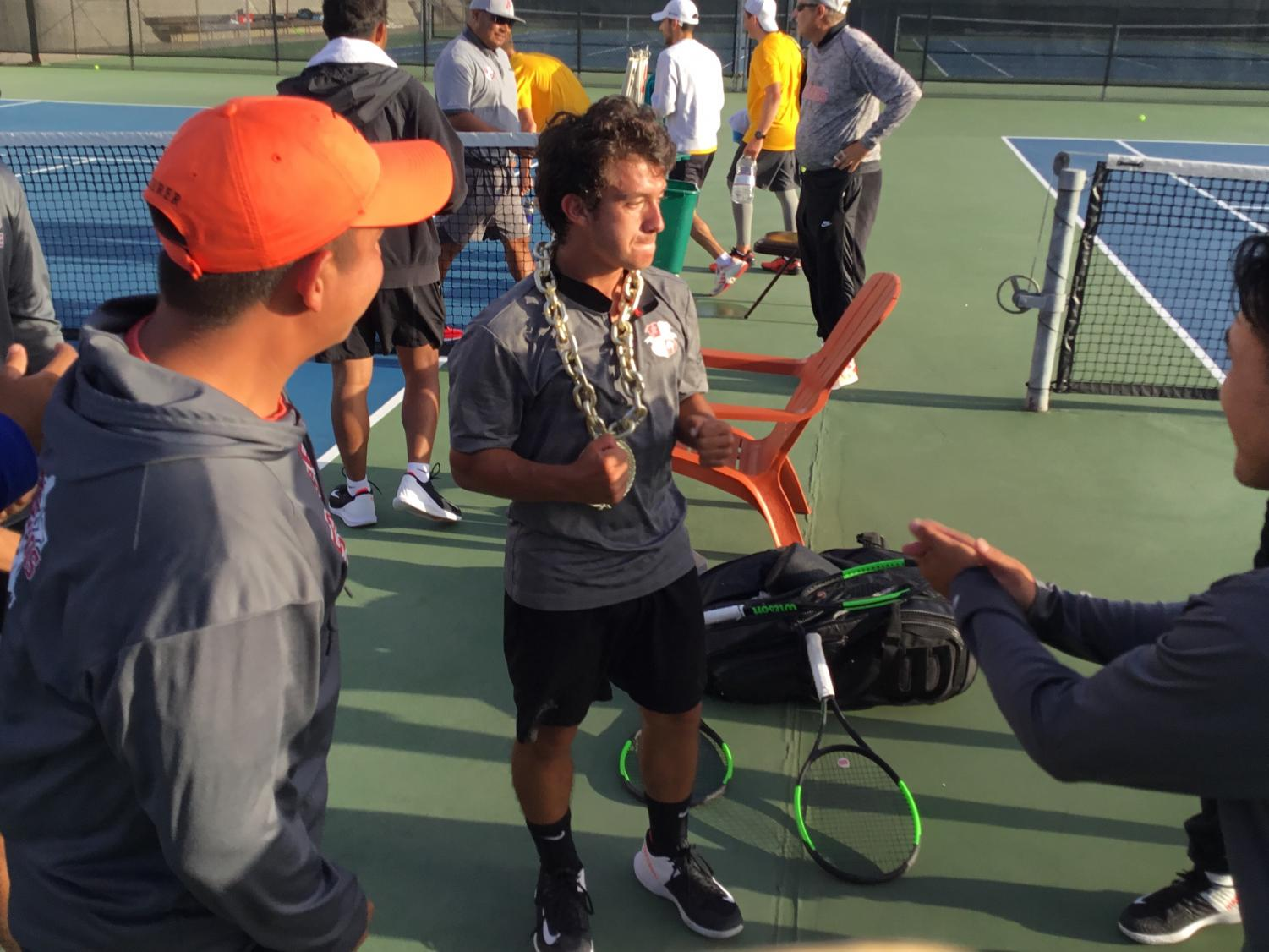San Diego City College's Colin Palmer secured the winning match fot the Knight's first round playoff win. By Sonny Garibay/City Times