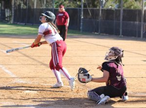 City College softball player looks to the outfield after she hit the ball.