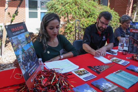 Representatives from SDSU sit at a booth at the 2019 transfer fair.