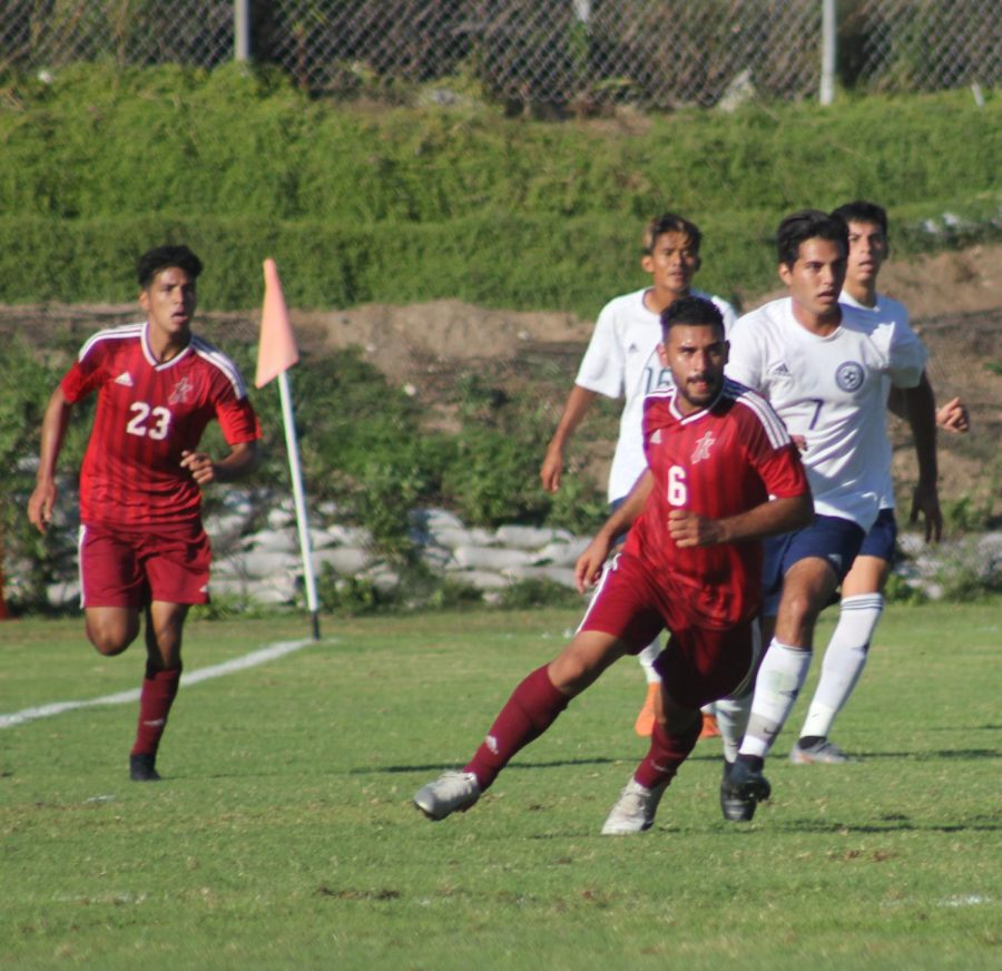 Christian+Velasquez+%286%29+and+Jordy+Robolledo+%2823%29+during+a+match+against+San+Diego+Mesa+Oct.+8.+Photo+by+Sonny+Garibay